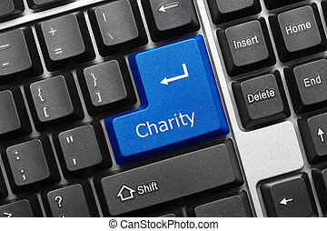 Conceptual keyboard - Charity blue key - Close-up view on...