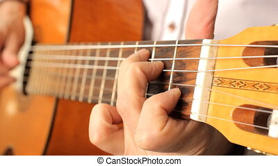 Hand of man playing guitar Acoustic black guitar playing,...