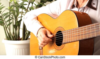 man playing a classical guitar. Acoustic guitar playing,...