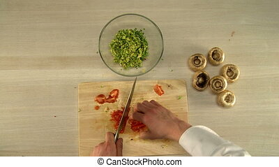 Cooking food Top view of chef finely cuts tomato - Cooking...