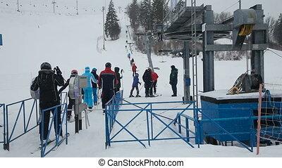 line of people ski lift