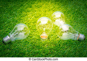 Eco concept - light bulb grow in the grass