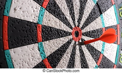 Playing Darts. Target hit. darts arrows in the target