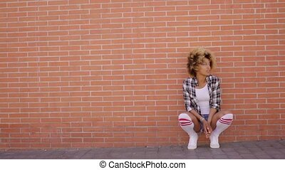 Young African American Girl Crouching - Wide shot of young...