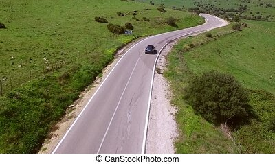 Aerial View Of The Road With Driving Car