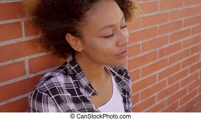 Portrait Of Black Woman At The Brick Wall - Young cheerful...