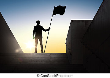 silhouette of businessman with flag over sun light -...