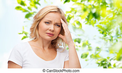 unhappy woman suffering from headache - people, healthcare,...