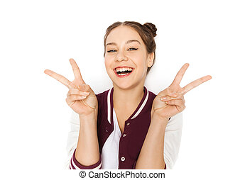 happy smiling teenage girl showing peace sign - people and...
