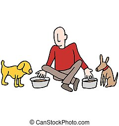 Man feeding his two dogs