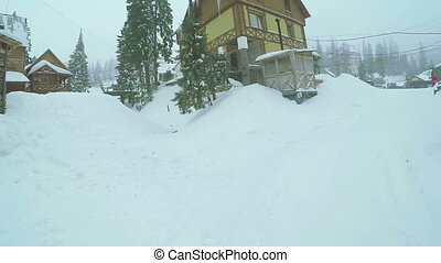 Ski resort in mountains - Wooden houses near ski slopes in...