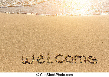 Welcome - word drawn on the beach - Welcome - word drawn on...