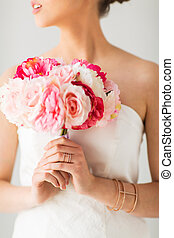 close up of woman or bride with flower bouquet - wedding,...