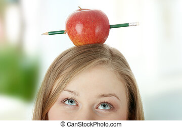 Learning - Beautiful student woman have one apple with...