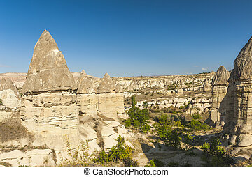 Fairy tale chimneys in Love Valley near Goreme, Cappadocia,...