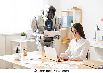 Pleasant girl and robot working in the office - Nice...