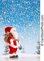 Santa Claus on the snow - Santa Claus with a big bag of...