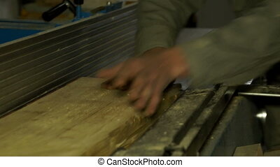 Piece of wood in a process of cutting - Piece of wood in a...