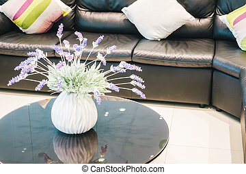 Vase flower decoration in living room interior with pillow...