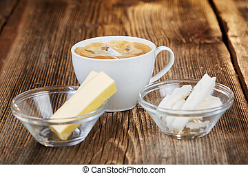 Coffee, butter and coconut oil for bulletproof coffee on a...