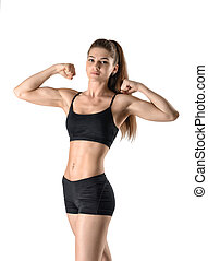 Cutout portrait of female model flexing her biceps standing...