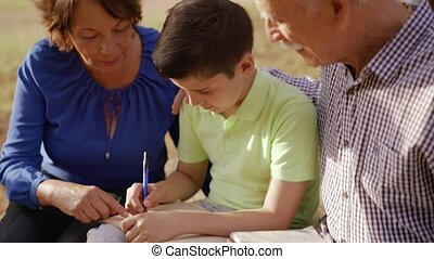 1-Grandpa And Grandma Helping Boy With Homework - Old and...