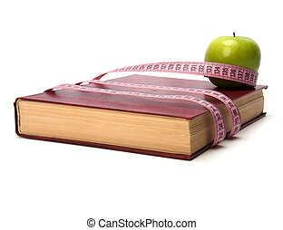 tape measure wrapped around book isolated on white...