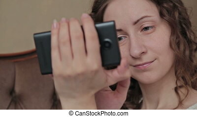 Girl using mobile phone - smartphone at home