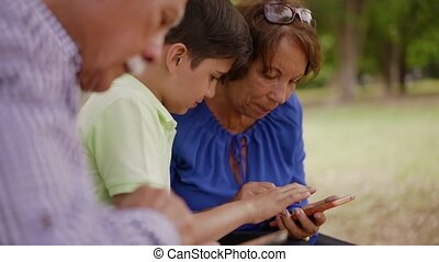 14-Child Helping Grandma Text Messaging On Mobile Phone -...
