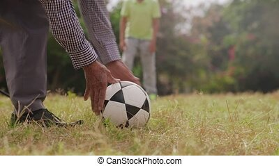 10-Grandpa Playing Soccer Football With Boy - Old and young...