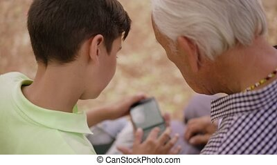 18-Boy Helps Senior Man Grandfather Using Mobile Phone - Old...