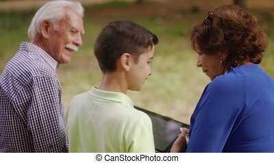 9-Happy Boy Studying School Homework With Grandparents -...