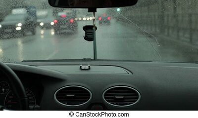Driving in rainy weather car driver inside