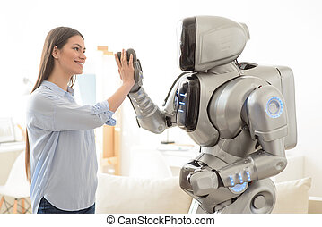 Positive girl and robot giving high five - We are the one...