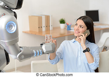 Pleasant girl getting water from the robot - Nice gesture....