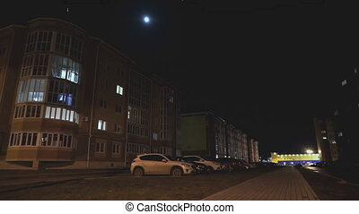 Multistorey apartment residential house at night. In...