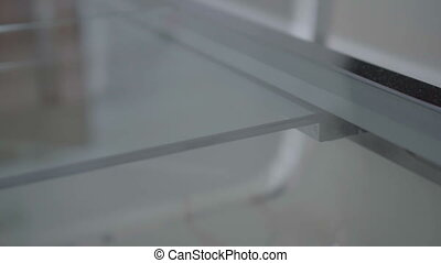 Putting optical glasses on the table - Closeup of putting...