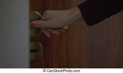 Beatiful woman entering apartment - Close-up of unlocking...