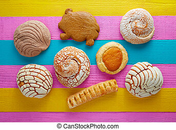 Mexican pastries concha puerquito ojo buey in a colorful...