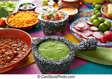 Green sauce with tomato and chili pepper in a mexican food...