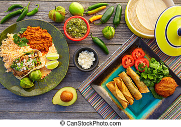 Mexican carnitas tacos with flautas from Mexico food...