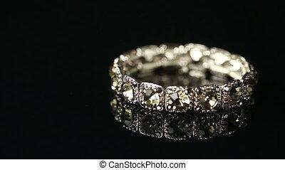 bracelet with many stones on reflective background - Diamond...