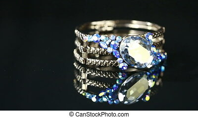 bracelet with many stones on reflective background - Diamond...