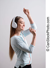 Overjoyed girl listening to music - Feel the rhythm....