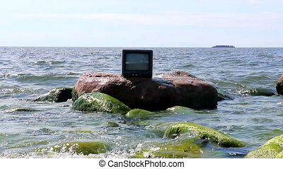 Concept: the love of TV. TV in sea - Concept: ubiquitous TV....