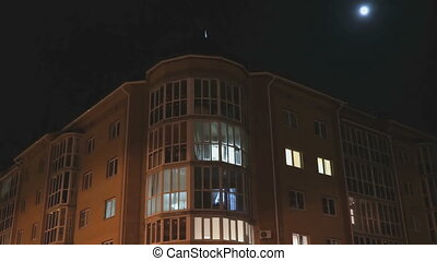 Multistorey apartment residential house at night