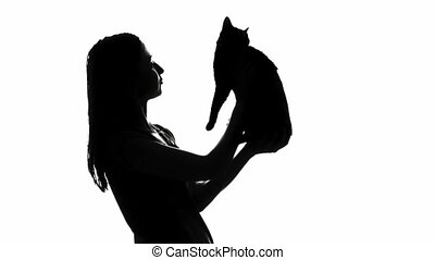 Woman with cat  - Silhouette of woman with cat, cat hit girl