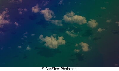 View Azure Sea through Clouds from Airliner Window -...