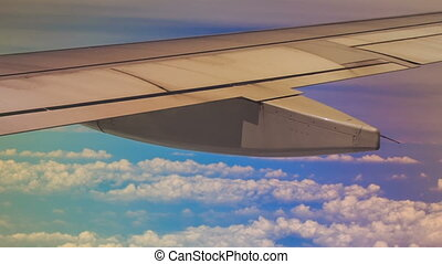 View White Clouds under Airliner Wing from Window