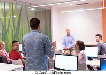 student answering a question in classroom